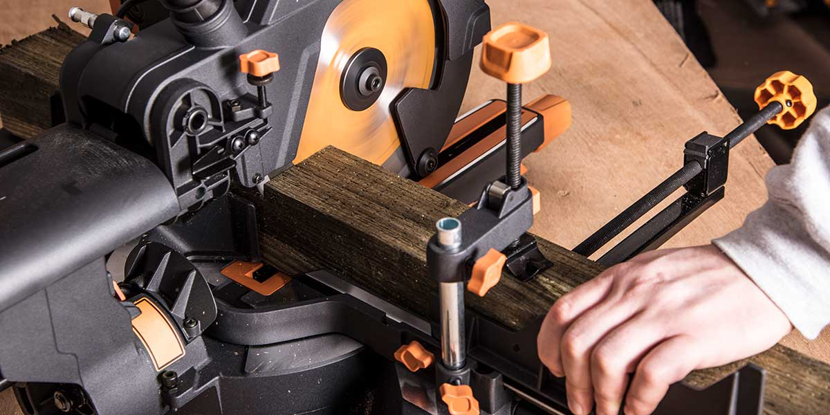 miter saw with a top clamp and front clamp